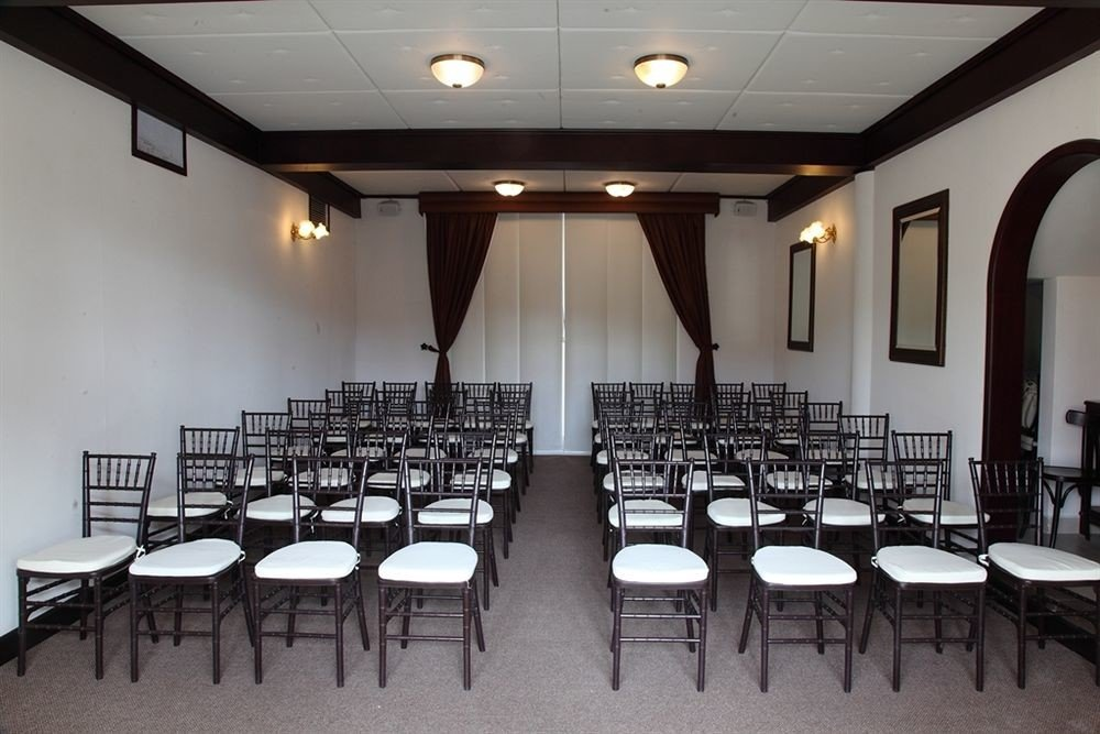 chair auditorium function hall conference hall long restaurant Dining convention center banquet ballroom cafeteria set lined dining table