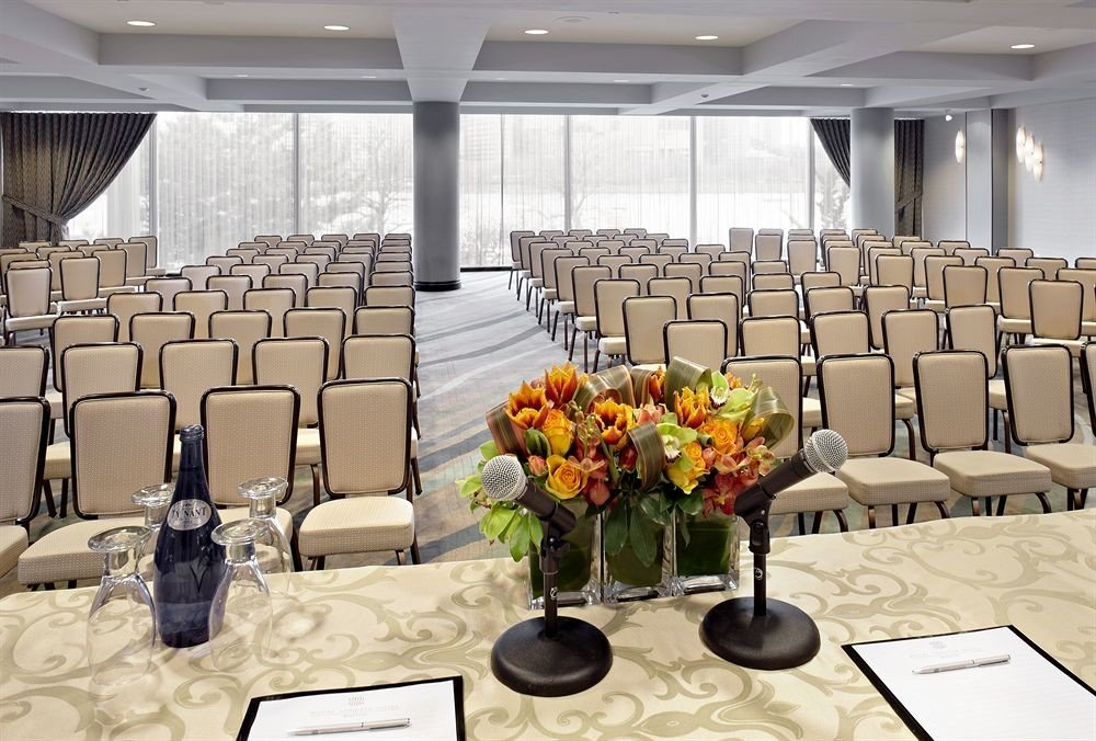 chair function hall banquet conference hall auditorium ceremony meeting ballroom convention center Dining convention overlooking conference room