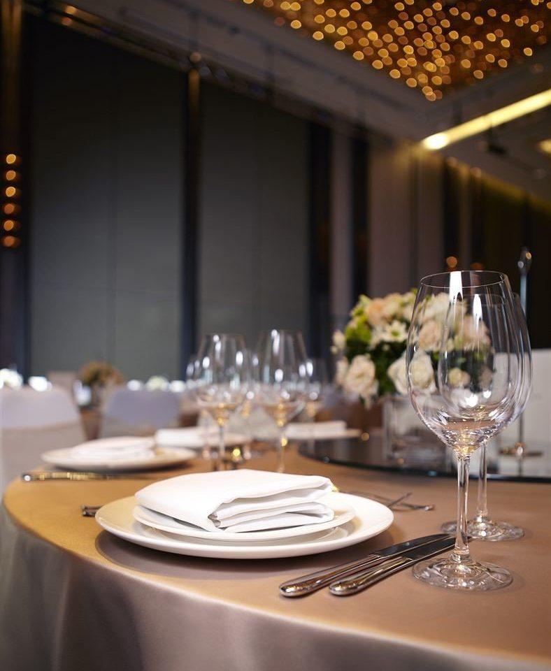 wine glasses restaurant function hall dinner Dining banquet rehearsal dinner wedding reception centrepiece ballroom empty dining table