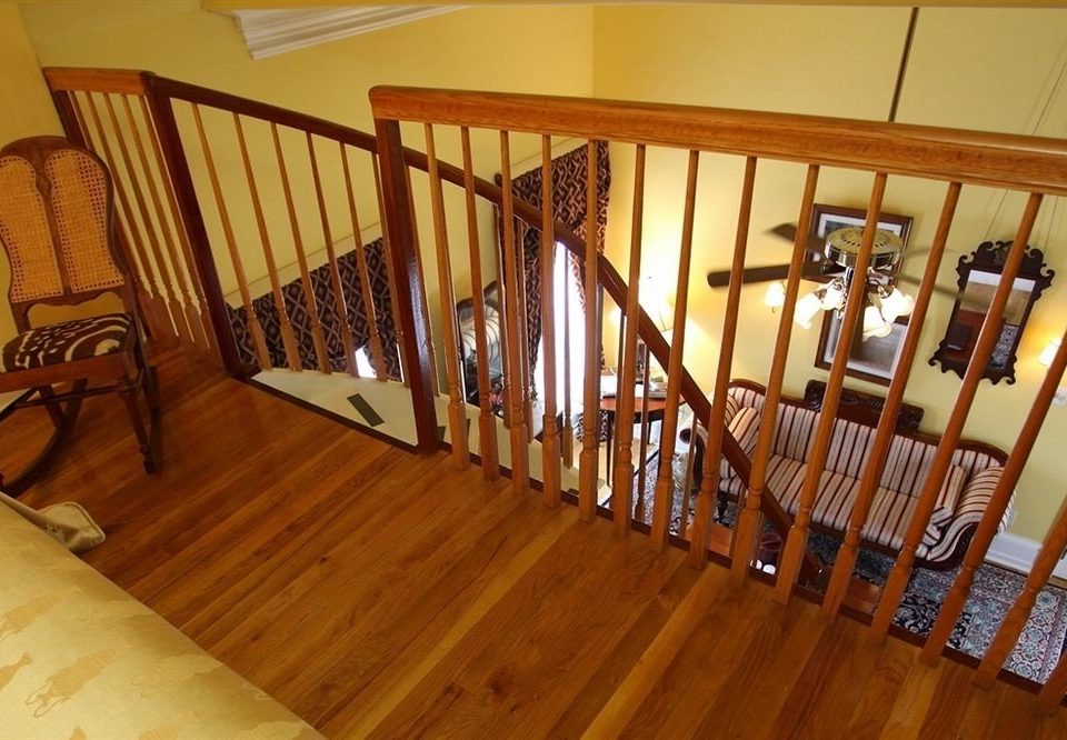 chair stairs property handrail hardwood baluster Dining wood flooring cottage flooring step dining table