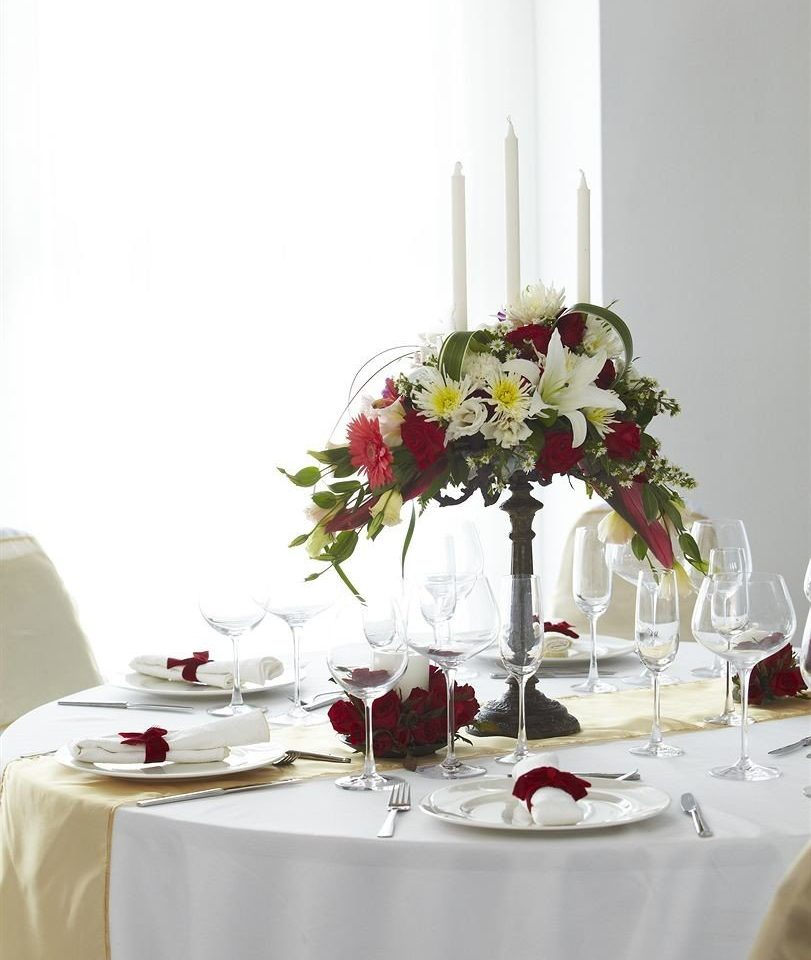 centrepiece glasses flower arranging flower floristry tablecloth lighting floral design wedding cake Dining banquet set dining table