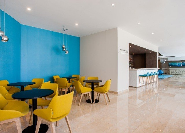 chair property yellow waiting room Dining condominium bright