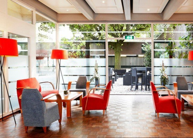 chair property building red condominium Dining waiting room home living room restaurant orange dining table