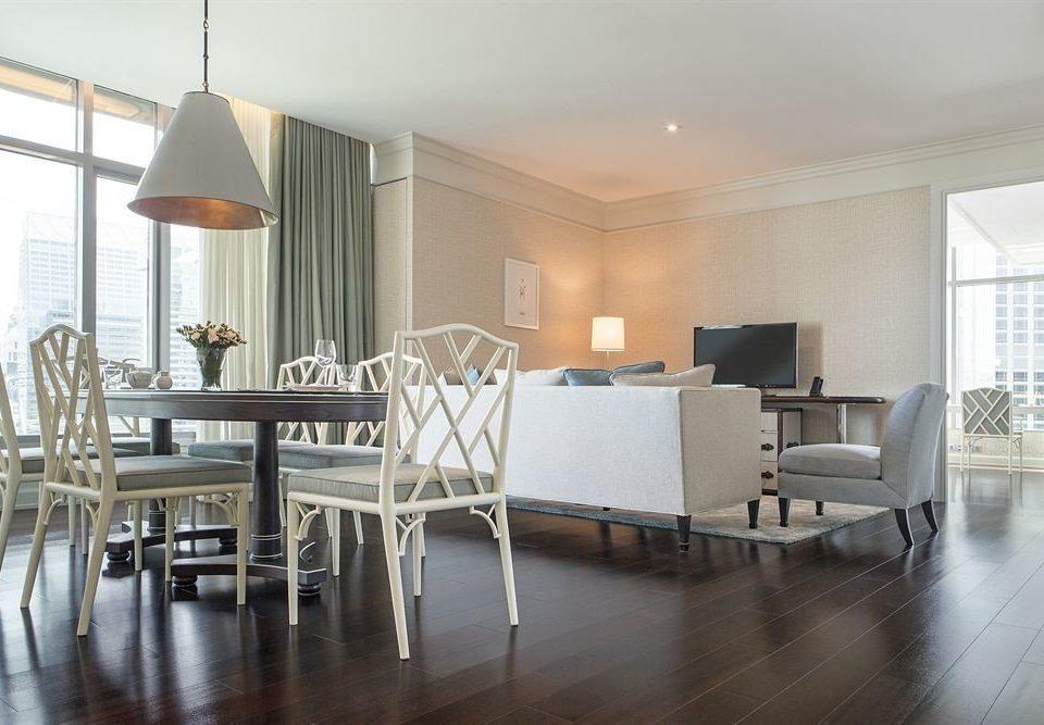 chair property Dining living room hardwood condominium home wood flooring loft flooring dining table
