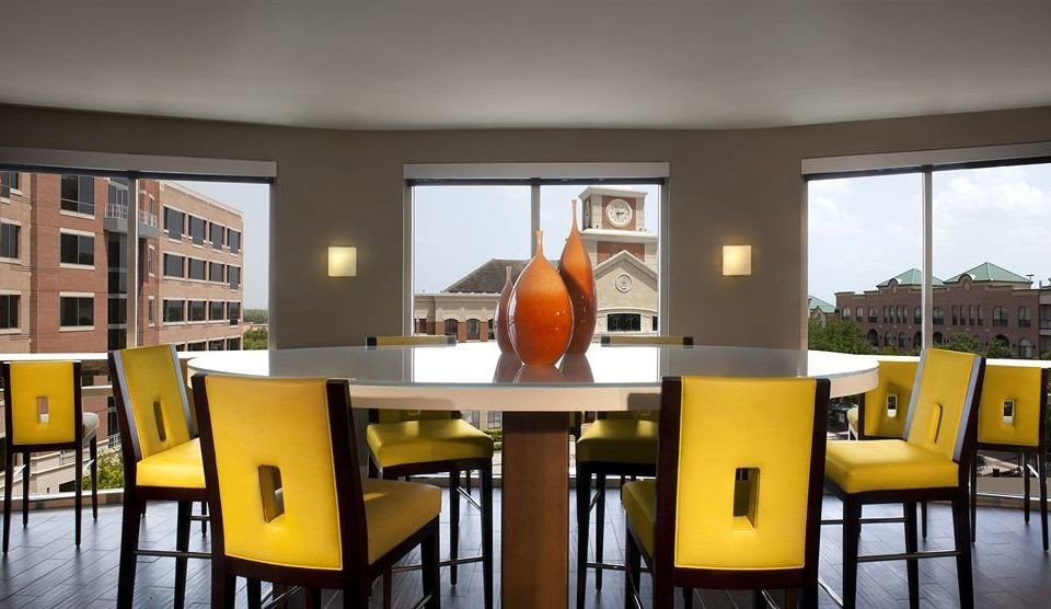 yellow chair property Dining home living room condominium dining table
