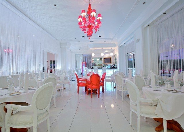 chair property Dining restaurant function hall white living room dining table