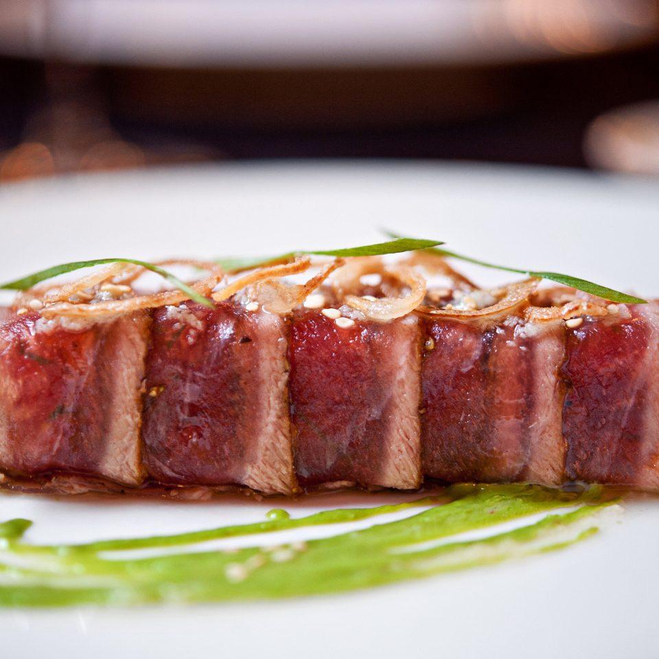 Dining Drink Eat plate food cake piece meat slice cuisine animal source foods pork dessert bacon close piece de resistance