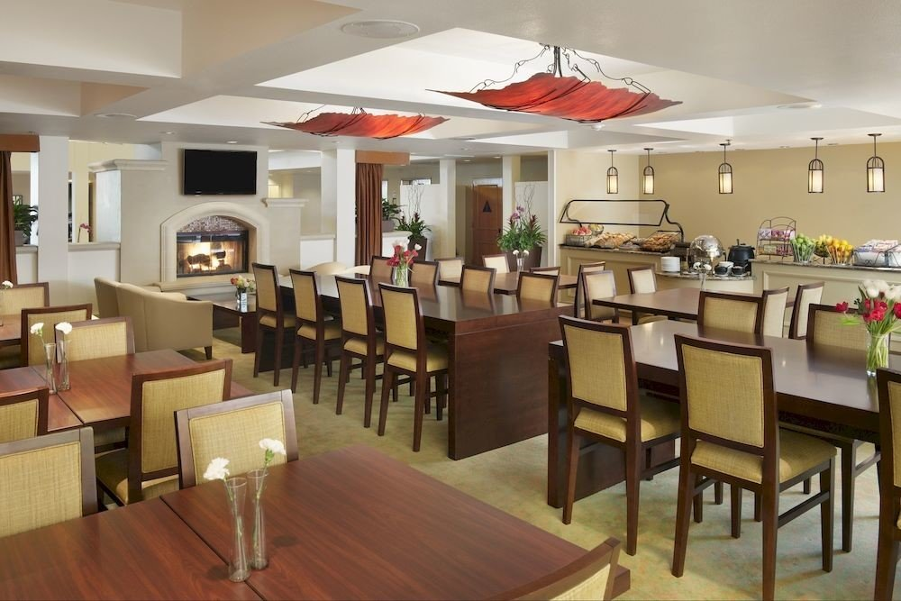 Drink Eat chair restaurant property cafeteria function hall café Dining dining table