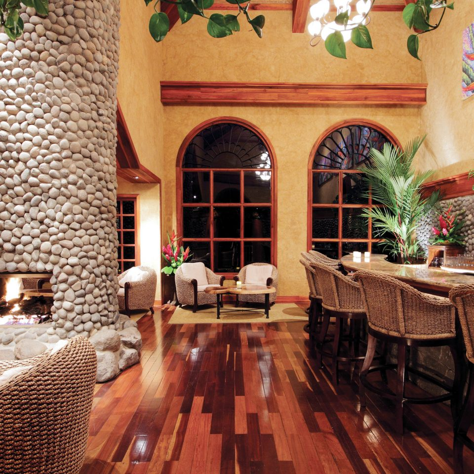 Dining Drink Eat Eco Fireplace Jungle Rustic chair property Resort Lobby home Villa living room mansion hacienda restaurant cottage Suite