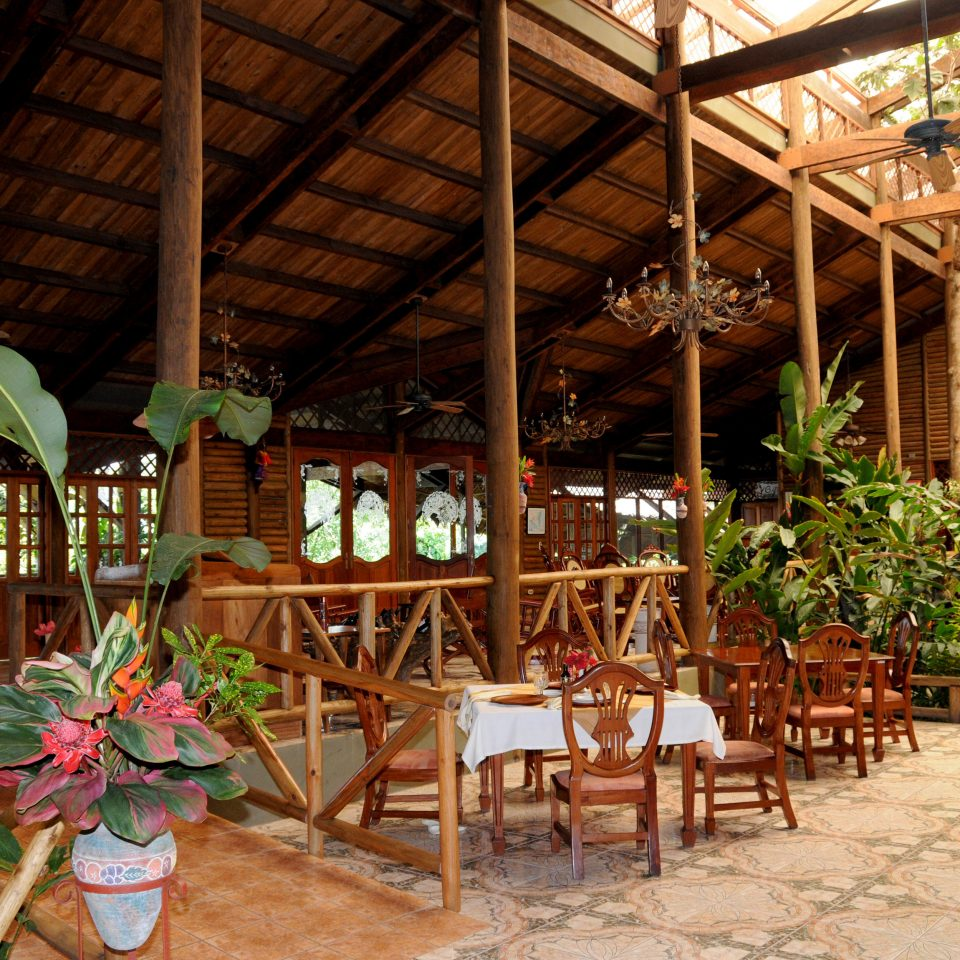 Dining Drink Eat Exterior Lodge Outdoors Rustic chair Resort outdoor structure restaurant hacienda eco hotel backyard cottage