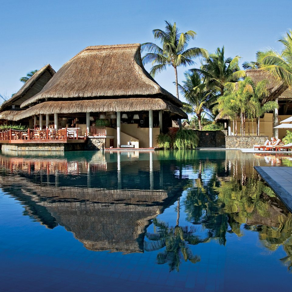 Dining Drink Eat Family Honeymoon Pool Resort Romance Romantic Tropical Waterfront tree water sky house swimming pool Village Lagoon dock surrounded lined Island