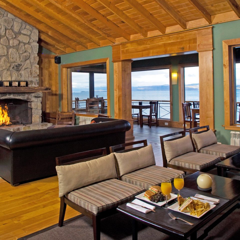 Dining Drink Eat Fireplace Lounge Luxury Mountains Patio Resort Scenic views property living room Villa home cottage condominium Suite
