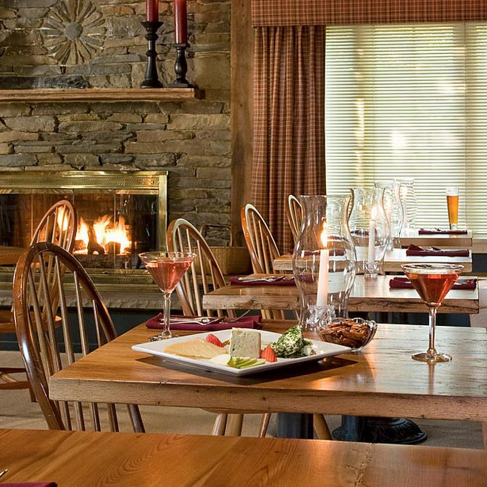 Dining Drink Eat Fireplace Inn Rustic chair property living room home restaurant cottage farmhouse dining table