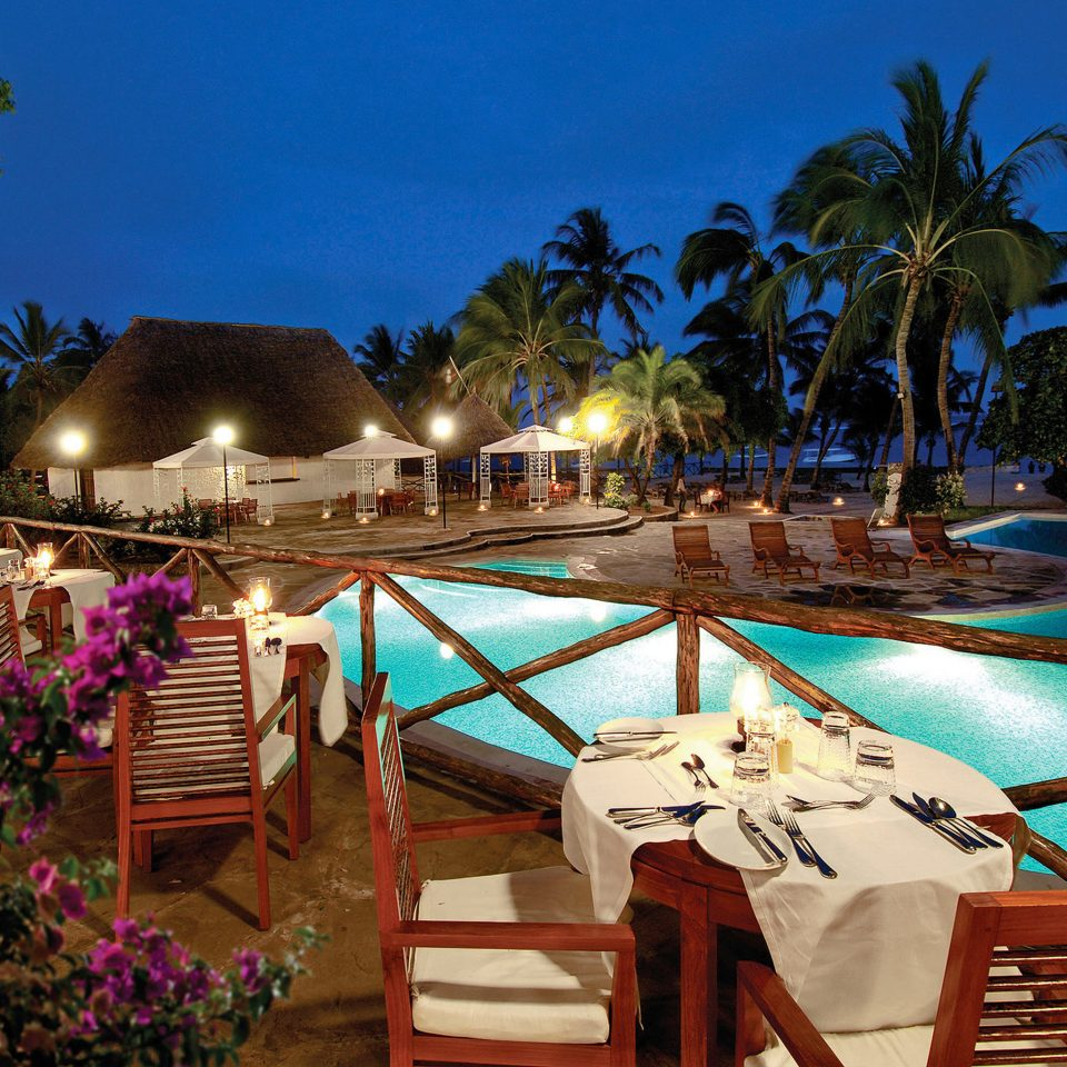 Dining Drink Eat Nightlife Play Pool Resort tree water leisure swimming pool restaurant Villa caribbean palm colorful Garden