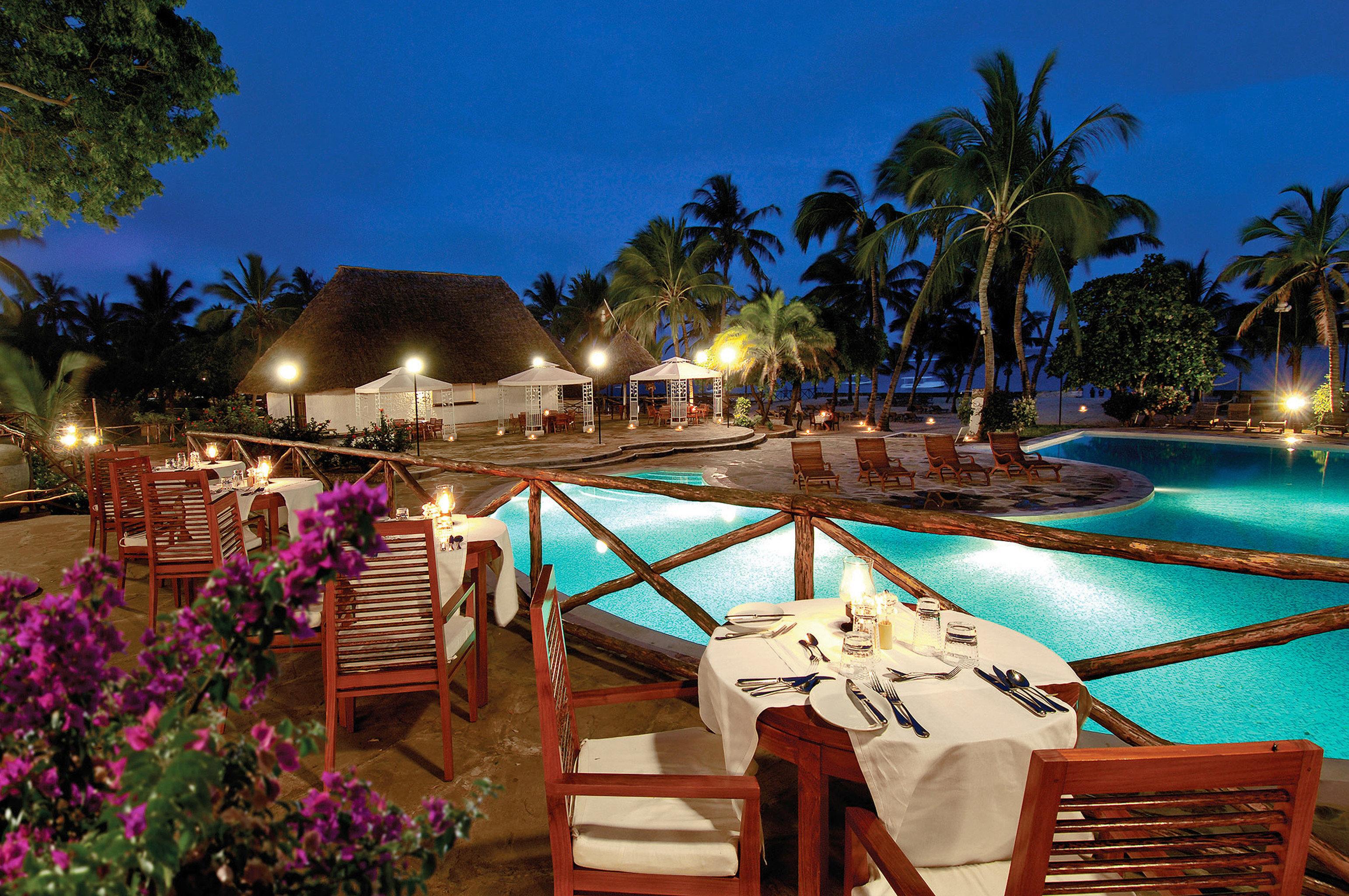 Dining Drink Eat Nightlife Play Pool Resort tree water leisure swimming pool restaurant Villa caribbean palm colorful Garden
