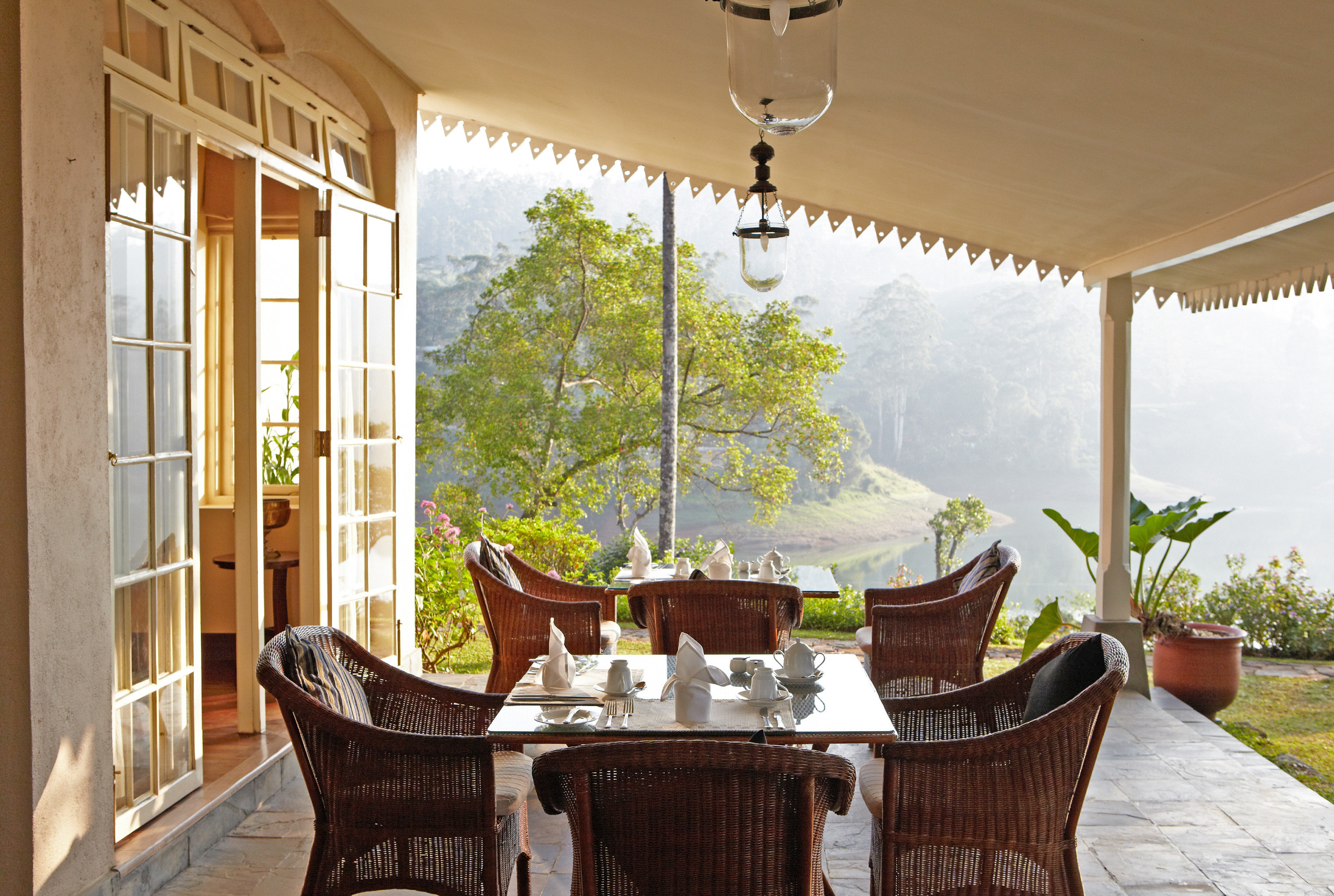 Dining Drink Eat Grounds Luxury Romantic Scenic views Terrace chair property house home living room porch cottage Villa farmhouse