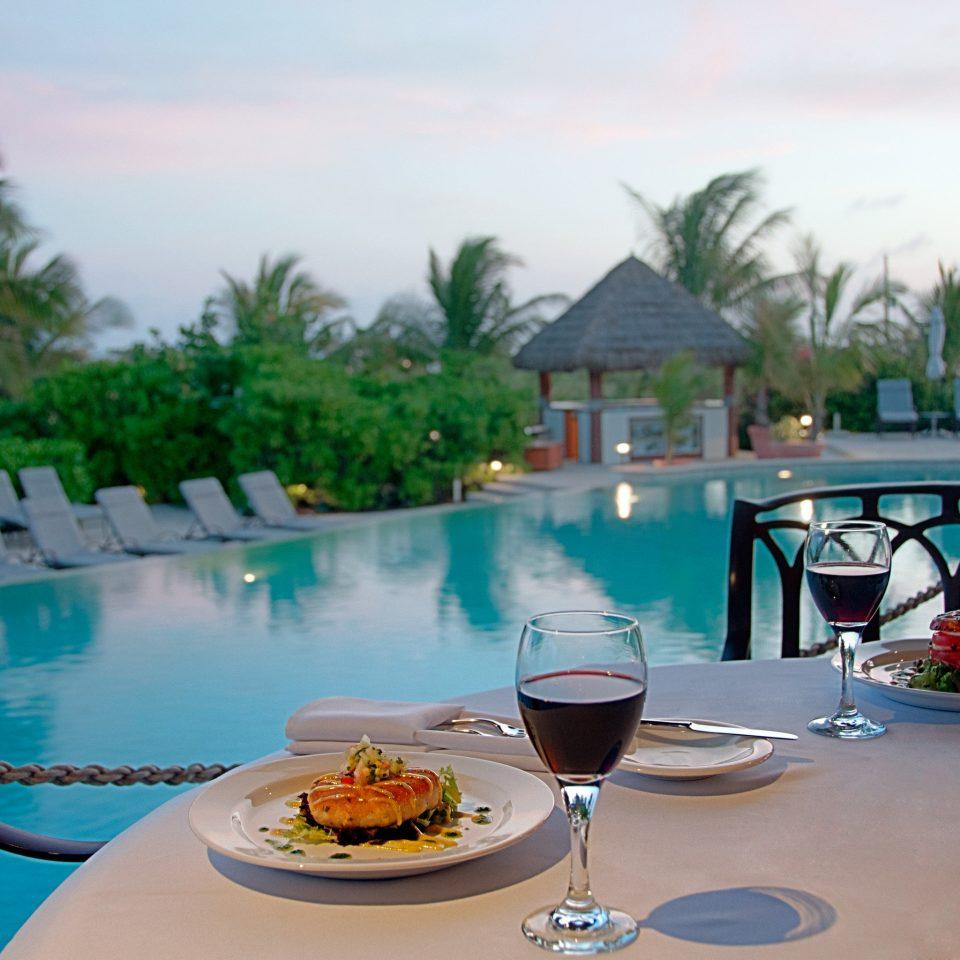 Dining Drink Eat Honeymoon Luxury Resort Romance property swimming pool leisure caribbean Villa restaurant condominium empty set dining table