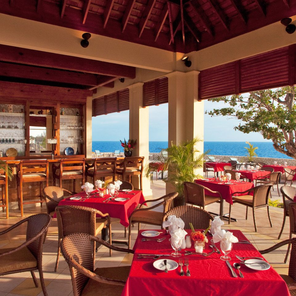 Dining Drink Eat Island Ocean Patio Terrace Tropical Waterfront chair restaurant Resort function hall banquet wedding reception