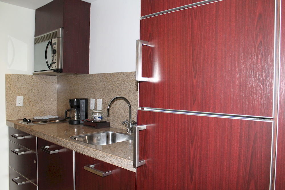 Dining Drink Eat Kitchen cabinet property red cabinetry steel countertop counter flooring stainless appliance kitchen appliance
