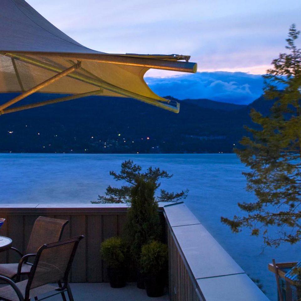 Dining Drink Eat Lounge Mountains sky tree blue evening Resort Sea sunlight