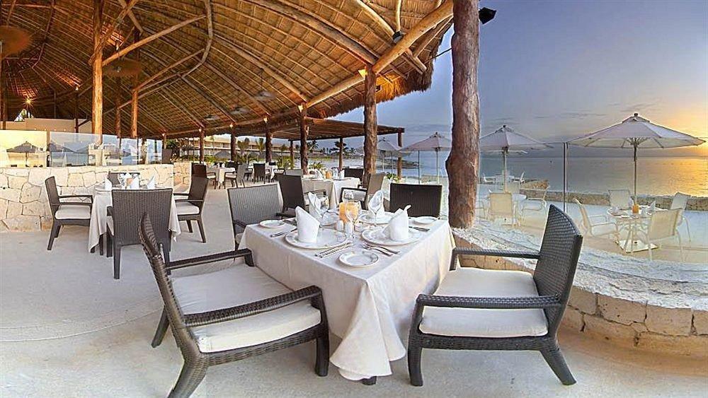 Dining Drink Eat Modern Resort Scenic views Waterfront chair property restaurant Villa