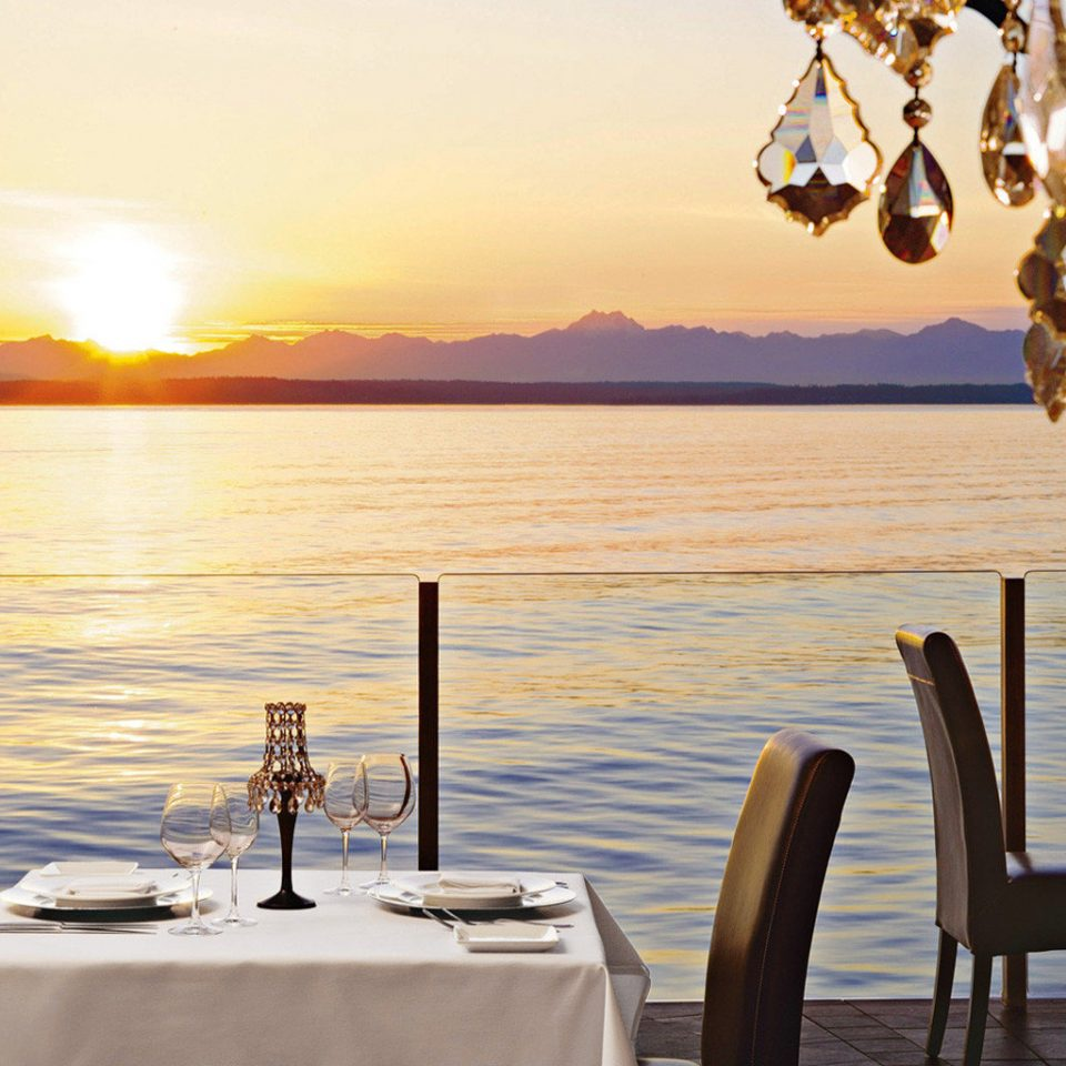 Dining Drink Eat Modern Scenic views Waterfront water sky chair restaurant evening vehicle Sea set overlooking dining table