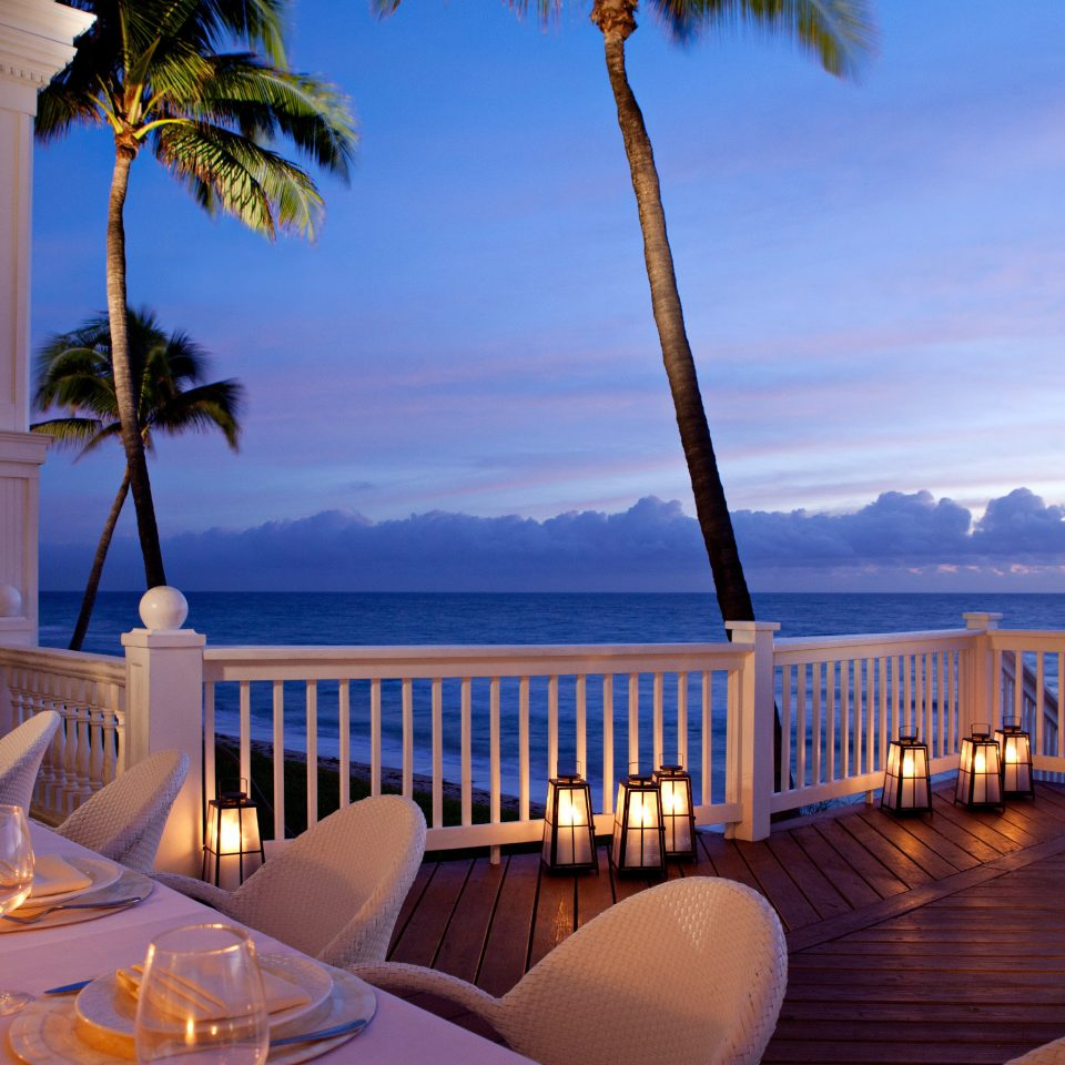 Dining Drink Eat Modern Resort Scenic views Sunset Waterfront sky water restaurant overlooking dining table