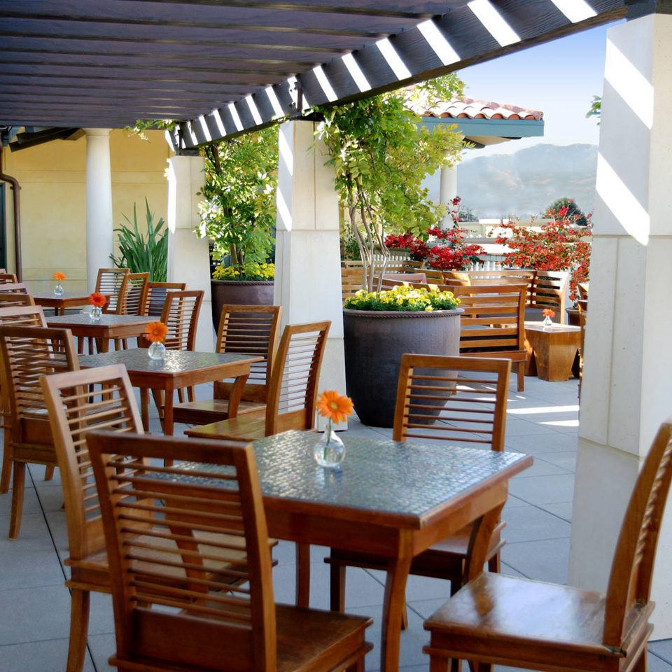 Dining Drink Eat Outdoors Patio Romance Scenic views Terrace chair property restaurant home cottage Resort outdoor structure Villa