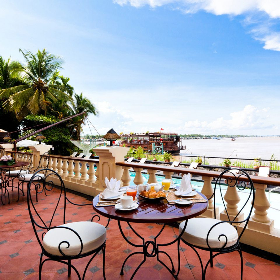 Dining Drink Eat Patio Terrace Tropical Waterfront sky leisure property Resort restaurant Villa palace