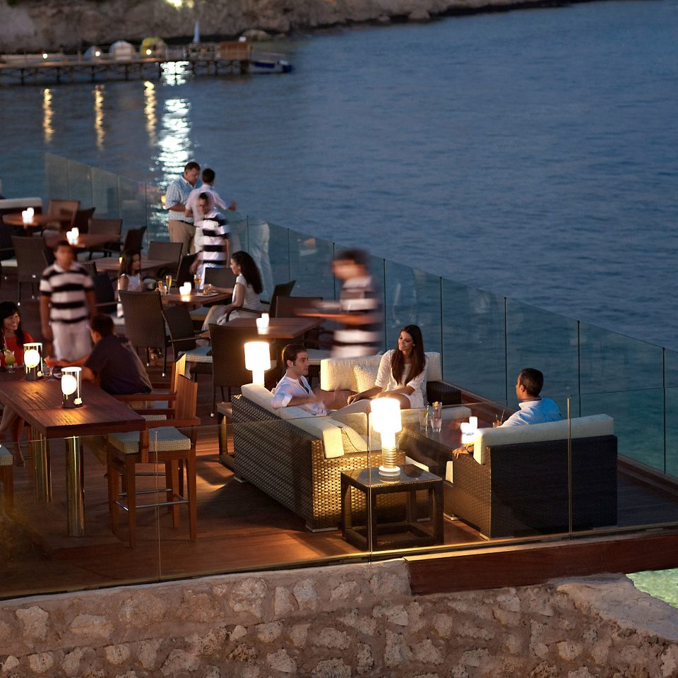 Dining Drink Eat Resort Scenic views Waterfront water evening vehicle