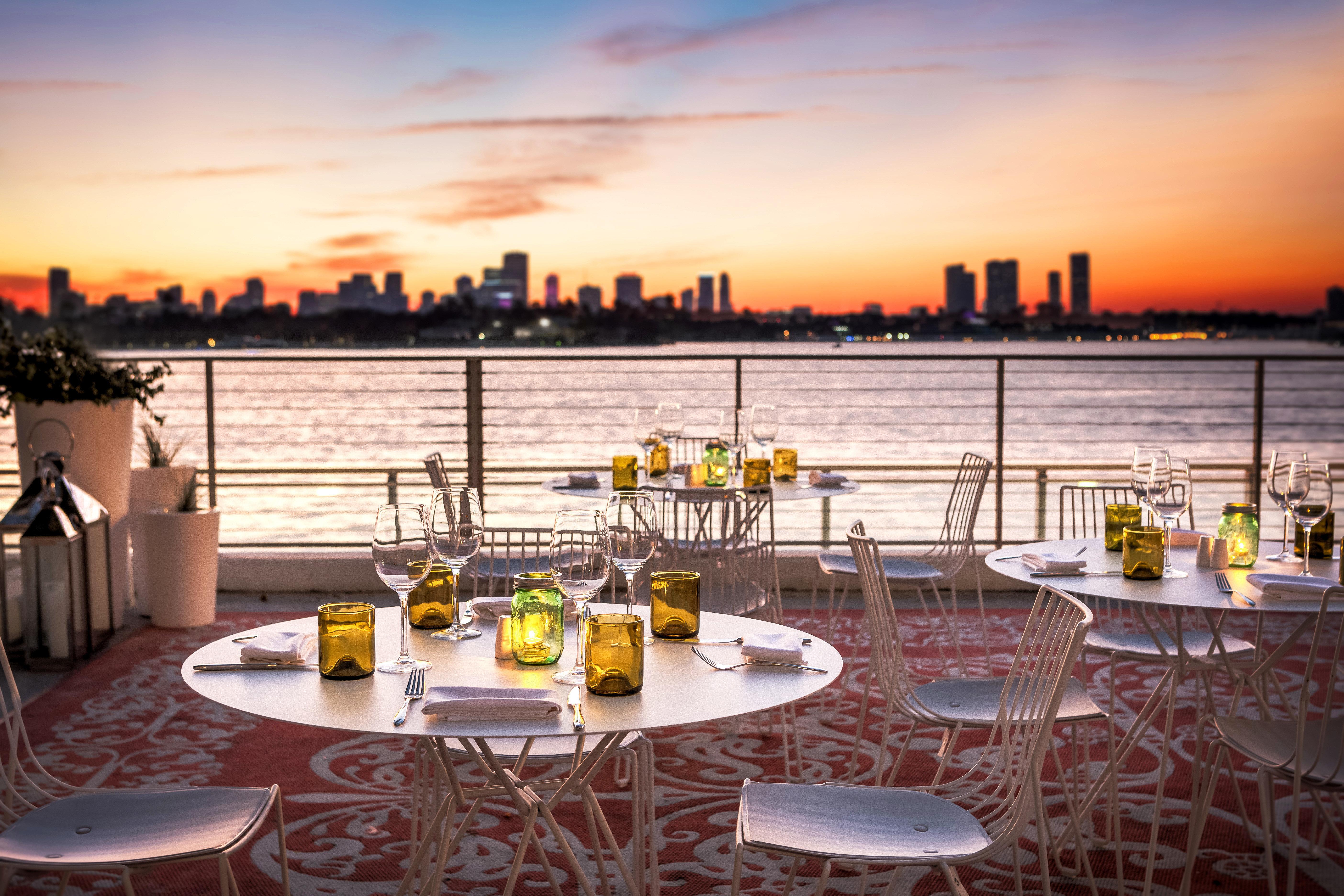 Dining Drink Eat Resort Sunset sky chair restaurant set