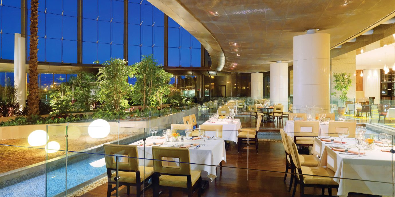 Dining Drink Modern Scenic views Lobby restaurant function hall Resort convention center condominium ballroom palace