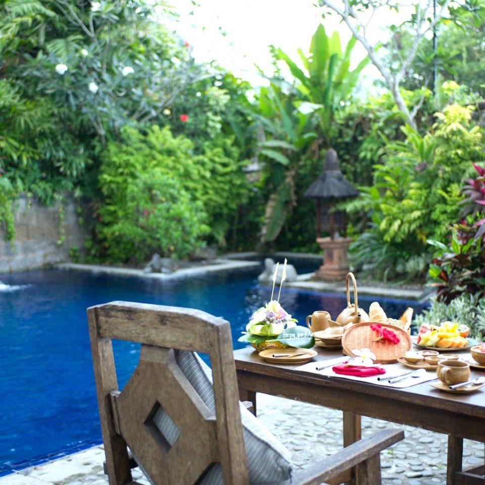 Dining Eat Garden Grounds Pool Rustic Tropical tree Resort backyard restaurant cottage