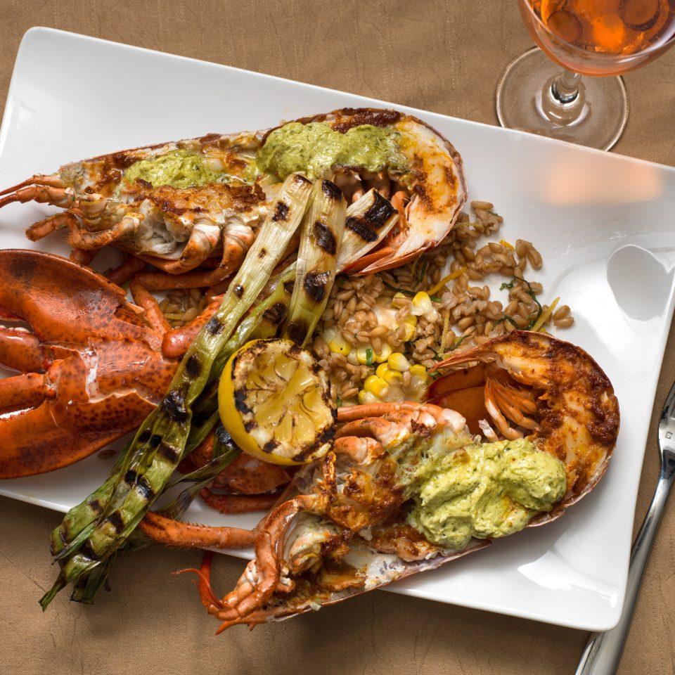 Dining Eat Luxury Resort food arthropod invertebrate plate animal Seafood cuisine fish animal source foods dungeness crab decapoda mussel meat lobster