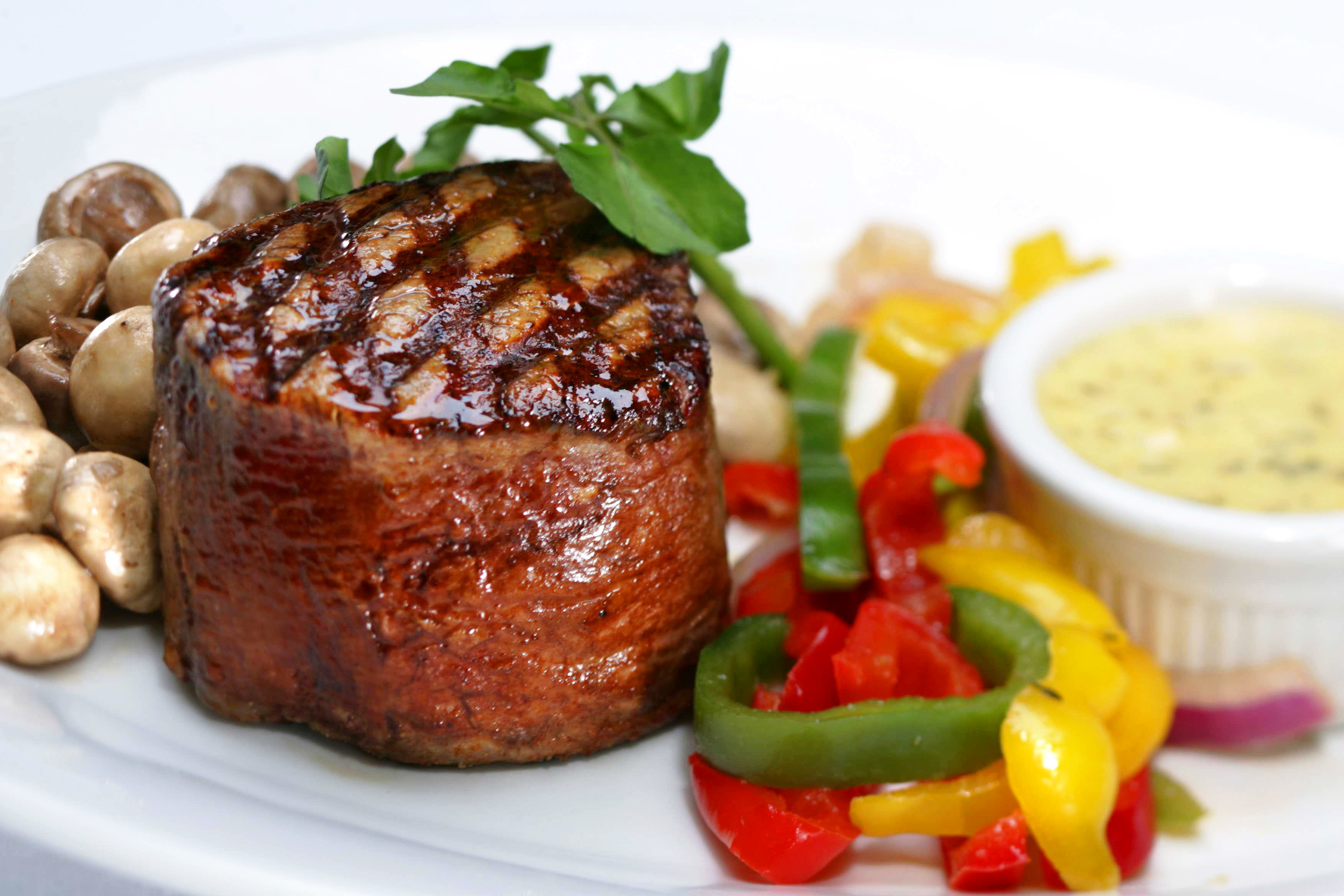 Dining Eat Resort food plate meat steak garnish cuisine pork chop beef tenderloin rib eye steak vegetable