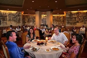 sitting group restaurant dinner eating seated long Dining lunch enjoying Family