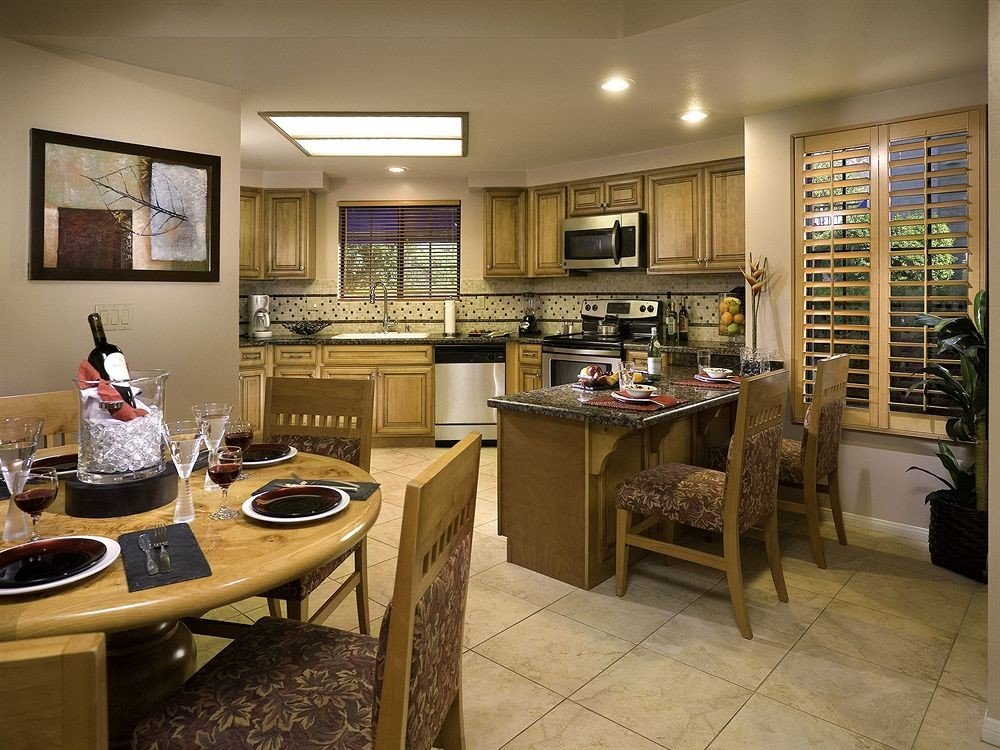 Dining Family Resort Suite Kitchen property home cabinetry hardwood living room condominium cottage countertop cuisine Island appliance