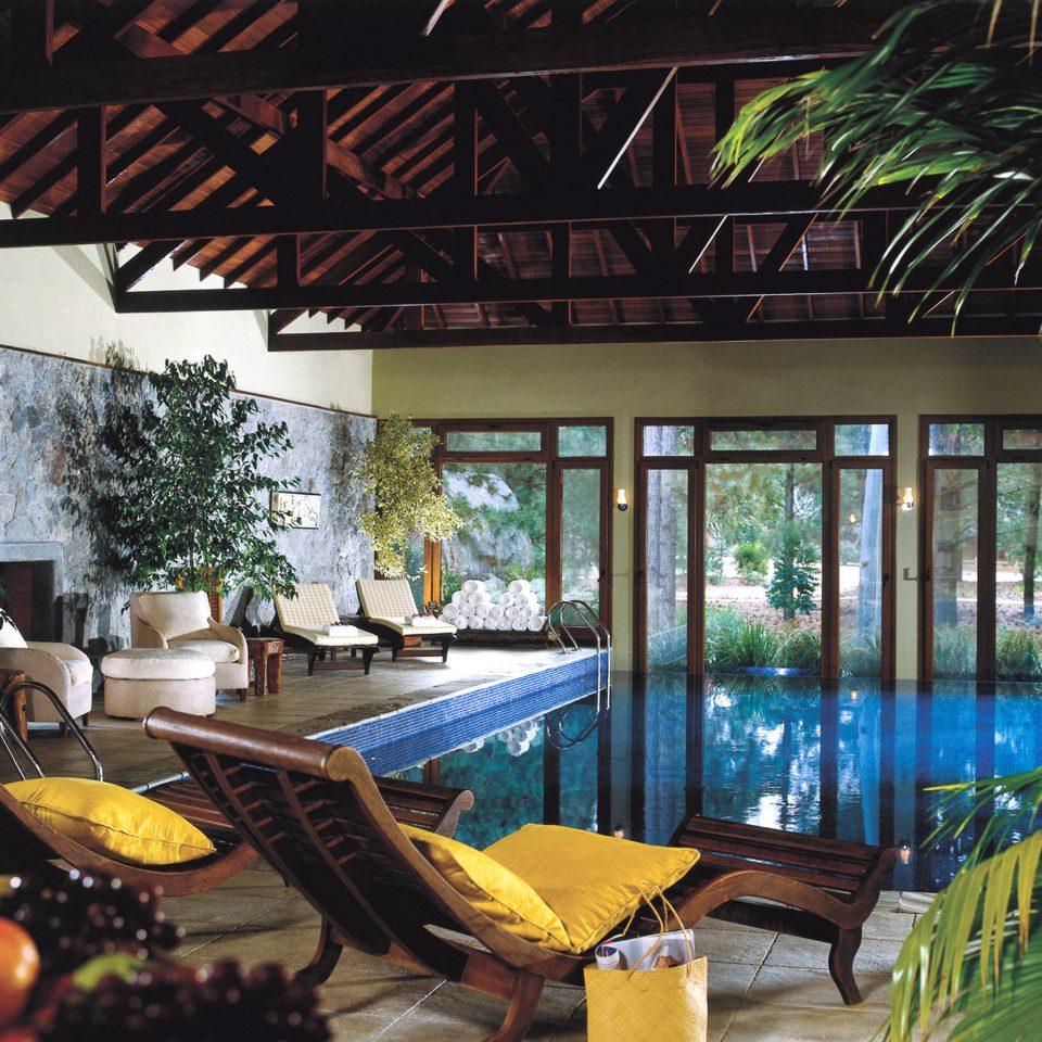 Family Luxury Pool Resort Rustic property home backyard restaurant Lobby condominium outdoor structure Dining Villa