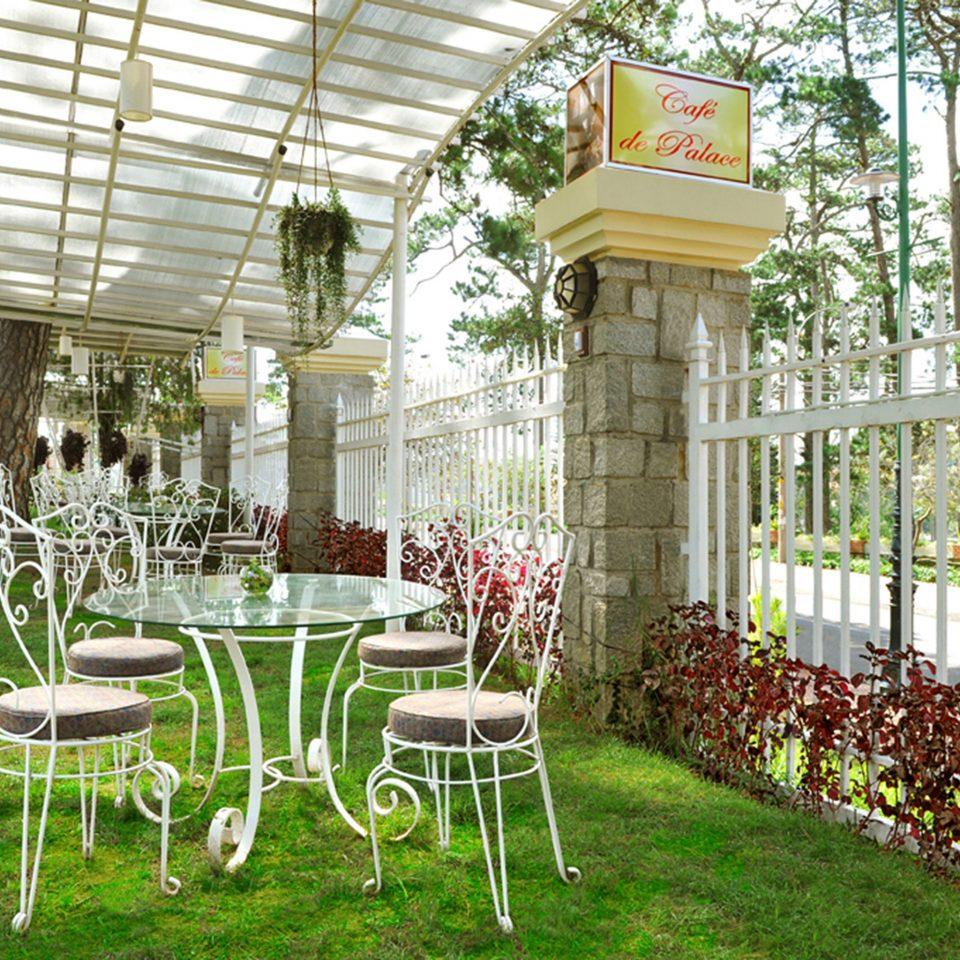 grass chair tree lawn aisle building porch Garden flower backyard outdoor structure floristry yard Dining orangery set