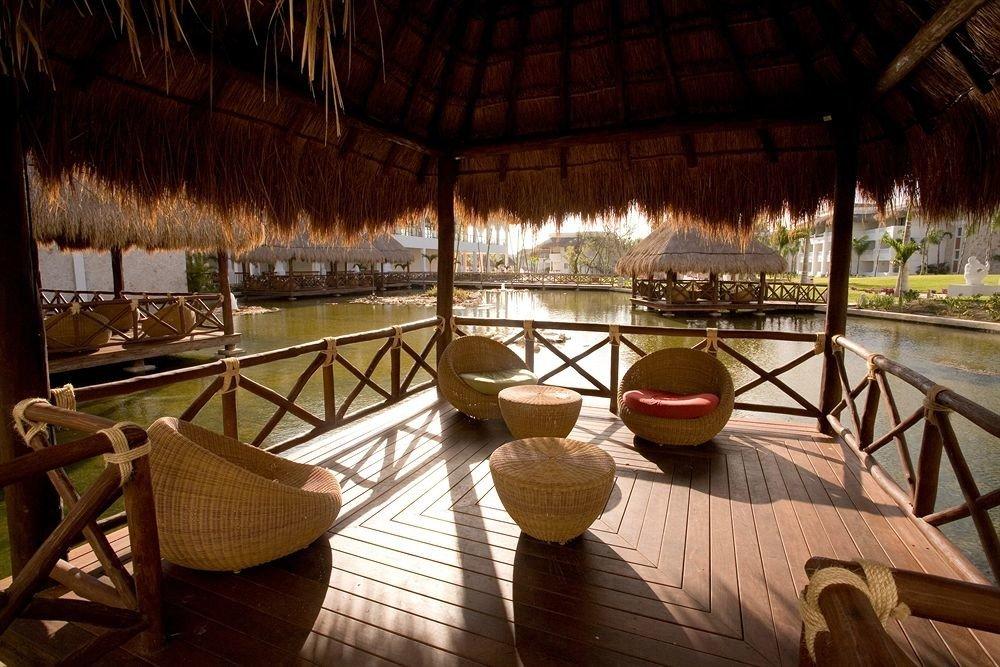 Hip Lounge Luxury Romantic Scenic views Tropical chair Resort restaurant Dining Villa set