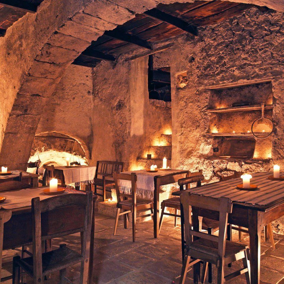Dining Honeymoon Romance Romantic Rustic chair restaurant ancient history tavern cuisine stone basement dining table