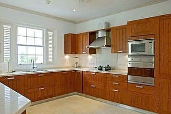 Dining Kitchen cabinet property appliance cabinetry countertop wooden hardwood cottage cuisine classique home stainless wood flooring steel Island