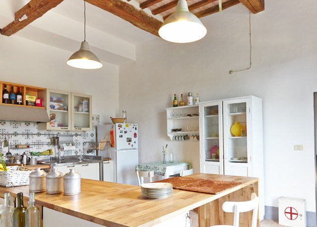 Kitchen property home cottage counter wooden farmhouse Dining cabinetry food Island