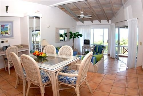 chair property Kitchen living room condominium home cottage Villa farmhouse Suite Dining Island dining table