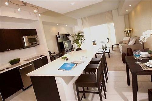 Kitchen property Dining condominium conference hall restaurant Suite Island