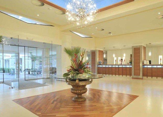 Lobby property Dining condominium home function hall wood flooring flooring ballroom Modern Island