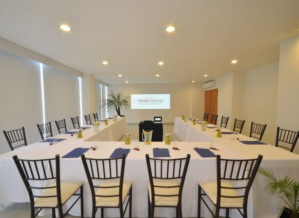 chair Dining property Kitchen function hall restaurant white conference hall banquet ballroom dining table