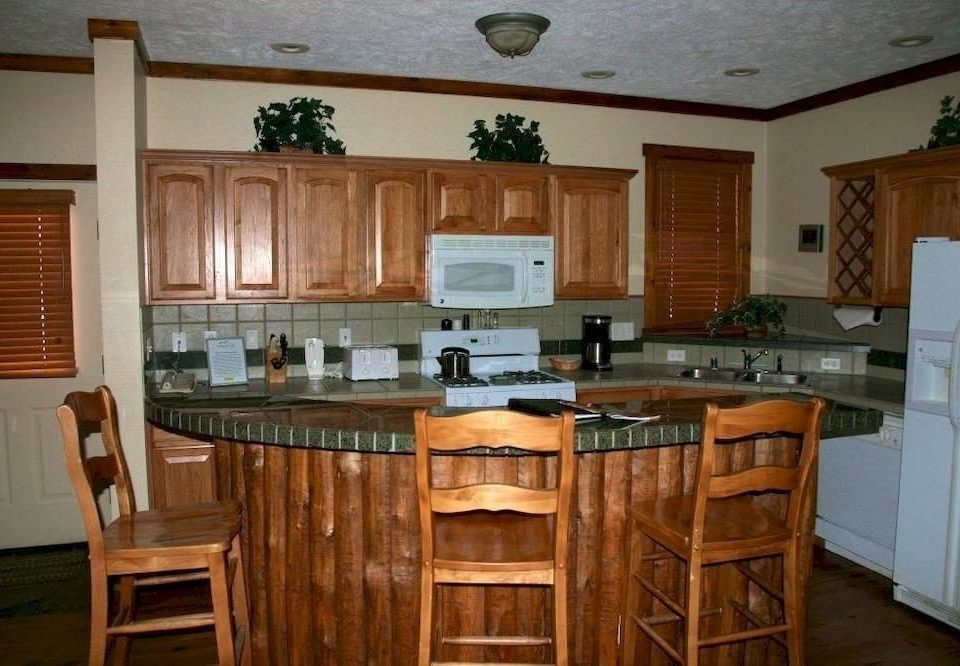 Kitchen chair property cabinetry home countertop wooden cottage hardwood cuisine classique farmhouse Dining