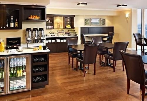 property cabinetry home hardwood Kitchen Dining wood flooring condominium dining table