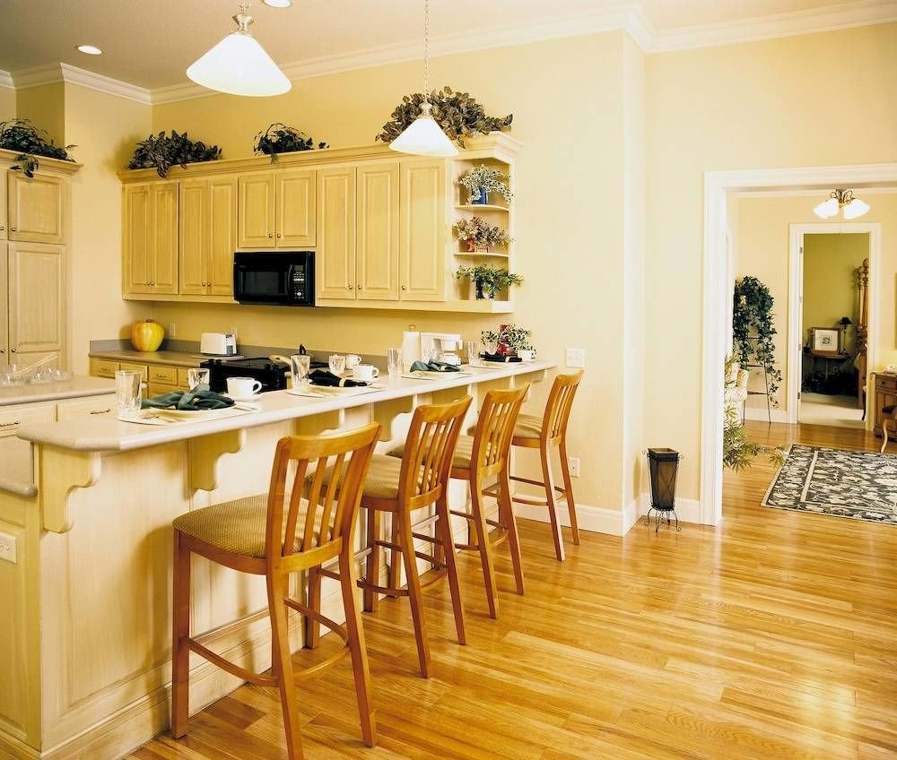 property Kitchen hardwood countertop cabinetry wood flooring home flooring cuisine classique Dining cottage farmhouse laminate flooring living room